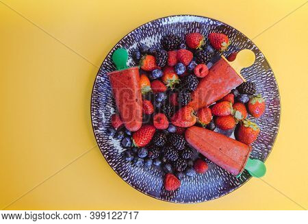 Top View Of Beautiful Plate With Raspberries, Blueberries, Strawberries And Blackberries And Homemad