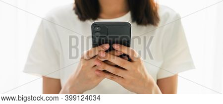 Close-up Of Woman Holding A Smartphone And Using Online Social On Lifestyle. Technology For Communic