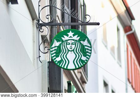Heidelberg, Germany - December 2020: Store Sign With Logo Of Multinational Chain Of Coffeehouses Cal
