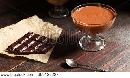 Chocolate Mousse In A Bowl On The Old Dark Brown Table Background
