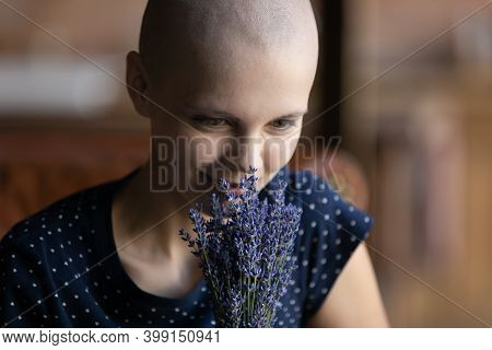 Close Up Hairless Sick Woman Holding Flowers, Dreaming About Recovery