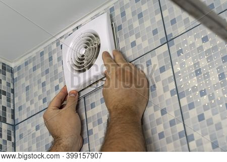 The Master Removes The Grate Very Dirty Exhaust Fan In The Bathroom