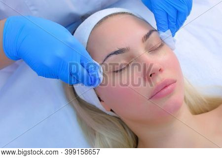 Cosmetologist Is Wiping Womans Face From Foam Using Antibacterial Napkins. Doctor Is Making Beauty P