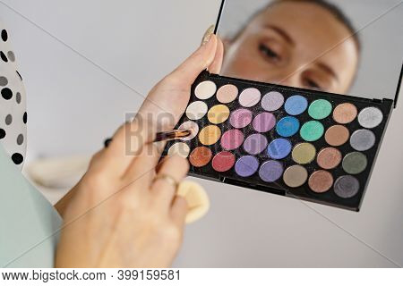Make-up Artist Picks Up Shadows With A Brush From An Eyeshadow Palette