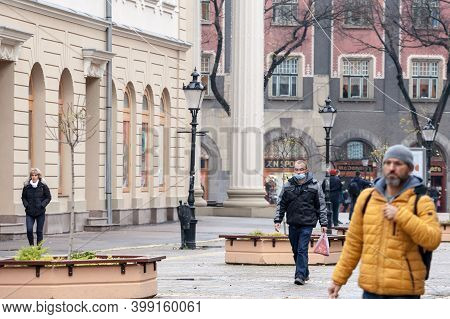 Subotica Serbia - November 20, 2020: Man Wearing A Respiratory Face Mask Walking In The Street Of Su