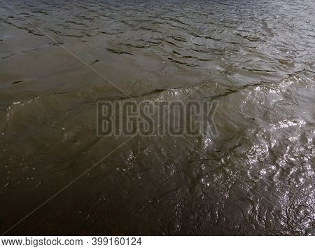 Murky Ominous Water, Turbulent Flow In River Or Stream, Dangerous Current