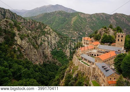 Birds-eye View Of The Abbaye Saint Martin De Canigou In The French Pyrenees. Abbaye On The Right Sid
