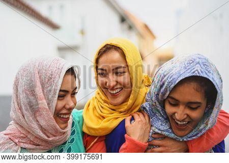 Happy Muslim Women Walking In The City Center - Arabian Young Girls Having Fun Spending Time And Lau