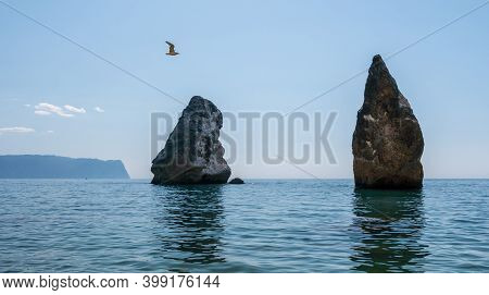 Summer Sea Landscape With Clear Sky And Volcanic Rocky Coastline. Calm Clear Sea, Small Waves On The