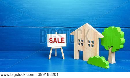 Residential Building Figurine And Easel Sale Sign. Home Purchase Proposal, Mortgage Loan. Lending Pr