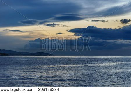 Sunset In  Vigo Estuary With A View Of The Horizon With Clouds Over The Sea