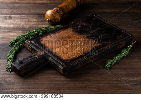 Void Wooden Background And Cutting Board With Wooden Texture And Scattered On It. Wooden Cutting Boa