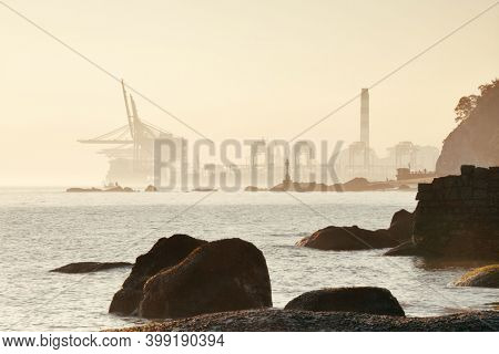 Xiamen city skyline and rock at shore in Fujian, China.