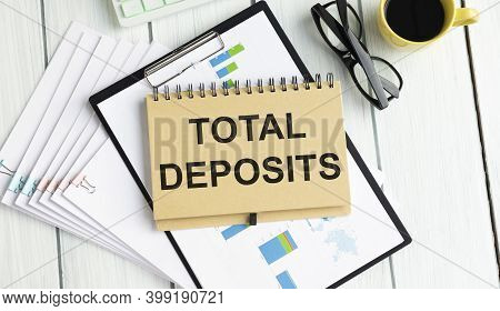 Notepad With The Inscription Total Deposits. Conceptual Image, Business Accessories, Calculator Isol