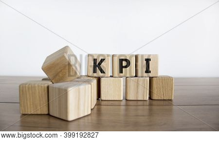 Kpi Symbol. Concept Word 'kpi - Key Perfomance Indicator' On Cubes On A Beautiful Wooden Table, Whit