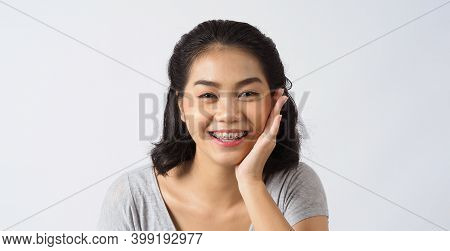 Dental Brace Beautiful Girl Smiling Looking On A Camera.