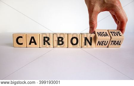 From Carbon Neutral To Negative. Hand Flips Cubes And Changes Words 'carbon Neutral' To 'carbon Nega