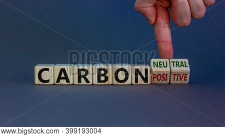 From Carbon Positive To Neutral. Hand Flips Cubes And Changes Words 'carbon Positive' To 'carbon Neu