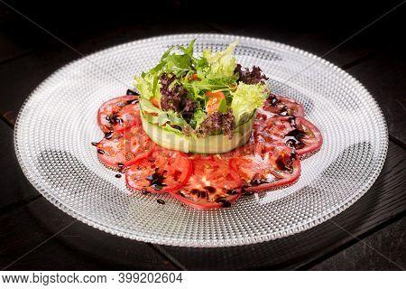 Salad With Crab And Avocado On Tomato Carpaccio