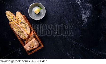 Delicious Homemade Italian Ciabatta Bread On Dark Concrete Background, Sliced Ciabatta Bread Above V