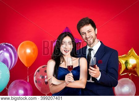 Couples Are Drinking To Celebrate The New Year Festival On A Red Background,happy New Year
