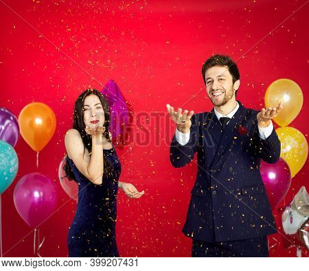 Lovers Are Happily Celebrating On The Red Background,happy New Year,merry Christmas