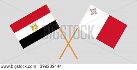Crossed Flags Of Egypt And Malta. Official Colors. Correct Proportion. Vector Illustration