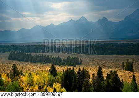 Late Afternoon Sunrays Shining Down Through The Haze Over The Grand Tetons