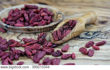 Dried Wolfberry Or Goji Berries On Olive Wood
