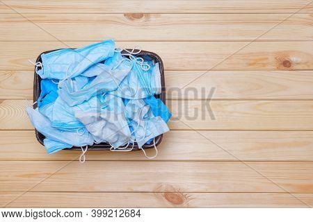 Coronavirus Garbage. Mask Into Trash Bin. Covid 19 Waste. Medical Waste. Discarded Surgical Masks. M