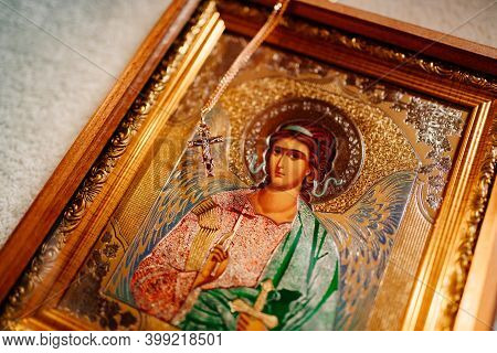 Golden Cross On The Chain And Christian Icon. Orthodox Baptism.