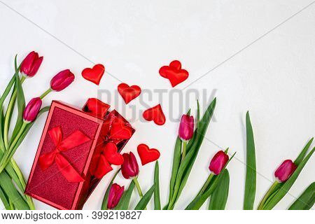 Red Tulips And A Gift Box With Valentines.