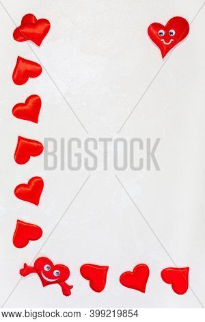 Red Heart Frame With Smiles And Hugs On A White Textured Background With Copy Space. Concept Of Vale