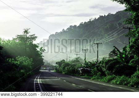 Beautiful Green Road In Countryside In The Morning, Landscape Road With Green Forest, Main Road On T