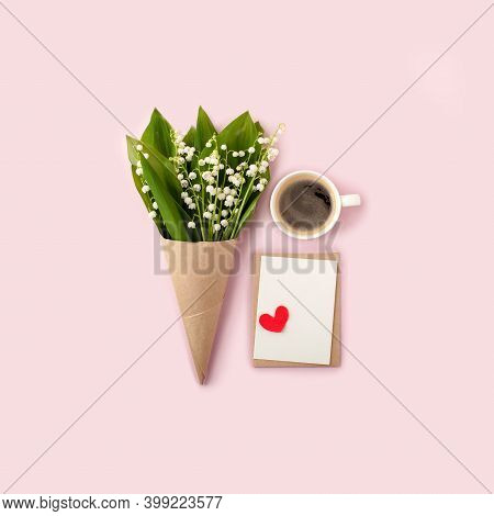 Bouquet Of Flowers And Cup Of Coffee And Mock Up Fpr Letter Message On Pink, Copy Space, Minimal Gre