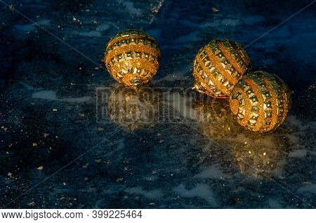 Golden Balls On Ice. Merry Christmas And Happy New Year. Christmas Background With Christmas Decorat