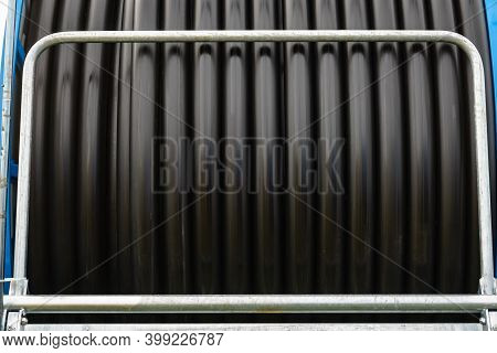 Irrigating With Hose Reel Irrigator. Rolled Up Of Black Rubber Hose, Industrial Detail.