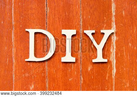 Alphabet Letter In Word Diy (abbreviation Of Do It Yourself) On Old Red Color Wood Plate Background