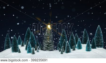 Snowing winter wonderland with miniature tree decorations and a sparkling star on Christmas tree.