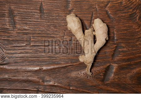 Close Up Of Fresh Ginger Root On Wooden Table