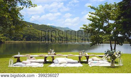 Tablescapes For Outdoor Lunch Set And Blue Sky Over The Mountain And Lake View On Background. Table