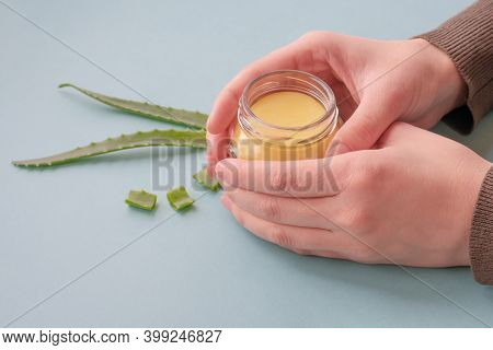 Young Female Hands Are Holding Translucent Jlass Jar With Cream Made Of Wax And Aloe Essence.revital