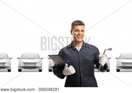 Auto repair mechanic worker with many cars and a tool in his hand isolated on white background