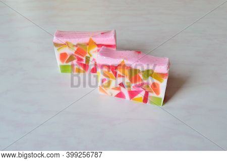 Two Pieces Of Original Handmade Soap With Splashes Of Geometric Shapes