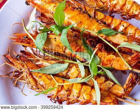 Plate With Barbecued Vietnamese River Prawns With Local Herbs At A Restaurant Along Dinh River Near
