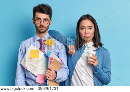 Multiracial Woman And Man Have Tired Sad Expressions Cooperate For Making Project Plan Strategy Disc