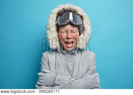 Photo Of Disappointed Woman With Red Frozen Face Cries As Feels Very Cold Spent Much Time Outdoor Du
