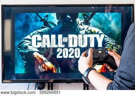 Woman Holding A Xbox Controller And Playing Popular Video Game Call Of Duty On A Television And Pc