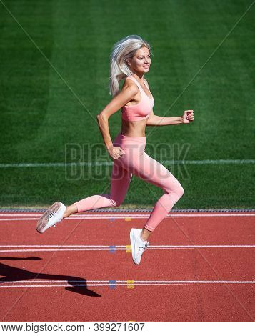 Lose Weight. Speed And Energy. Stamina. Sexy Runner In Fitness Sportswear. Sprinting On Outdoor Aren