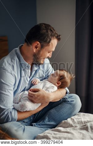 Fathers Day. Middle Age Caucasian Father With Sleeping Newborn Baby Girl. Parent Holding Child Daugh
